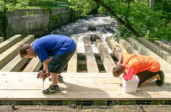 Photo of volunteers working on the Mascoma River Greenway Rail Trail.